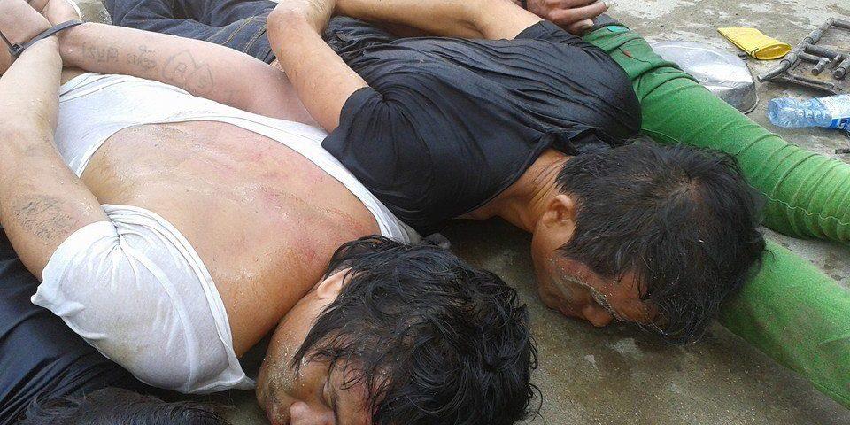 Arbeiter liegen nach gewaltsamen Zusammenstößen gefesselt am Boden © Central
