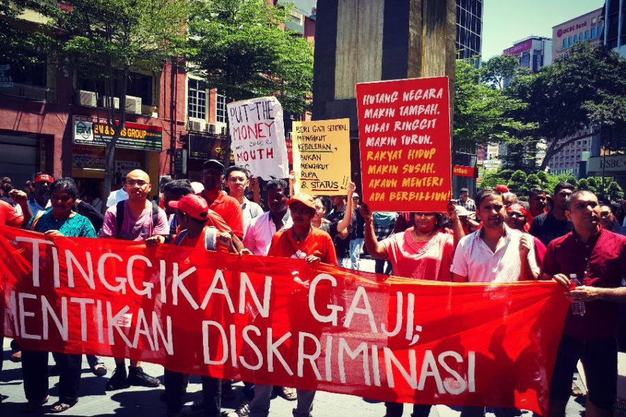 """""""Erhöht die Löhne, beendet Diskriminierung"""" – Das Motto der diesjährigen 1. Mai Demonstration in Kuala Lumpur © Choo Chon Kai"""